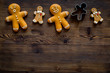 Quadro Gingerbread man on dark wooden background top view copyspace