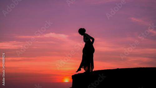 Fotobehang Jacht silhouette of woman on cliff,braves confident concept.