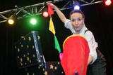 magician woman performing on stage - 174990971