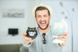 man smiling happiness piggy bank saving portrait concept - 174992594