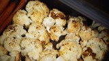 Hand taking vegetables out of the oven. Roasted fresh cauliflower and carrot on baking tray. Cooking healty diet. 4K ProRes HQ codec - 174999537