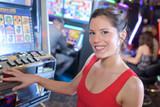 beautiful woman in red dress playing slot machine - 175003162