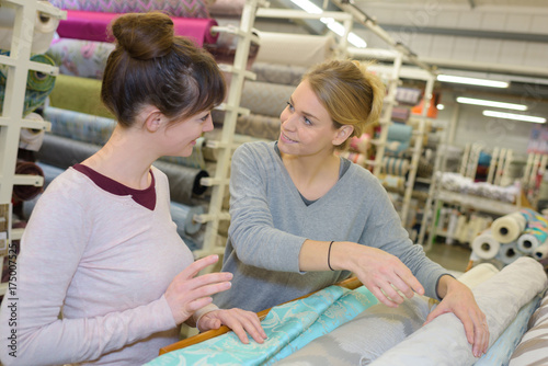 two females at a fabric shop Poster