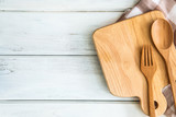 chopping board with wooden fork and spoon on white table , recipes food  for healthy habits shot note background concept - 175022308