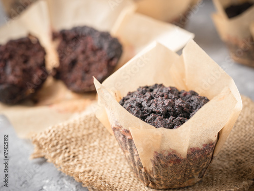 Gluten-free vegan chocolate muffins with beetroot, almond powder, buckwheat flour and karob or cocoa Poster