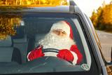 Authentic Santa Claus. Santa Claus drives a car.