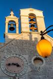 Historic center of the Croatian town of Sibenik at the Mediterranean Sea, Europe. Belfry, city clock, illuminated lamp at sunset. - 175031321