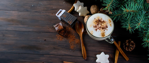 Cup of hot coffee latte, cinnamon, cookies and fir branches. © vimart