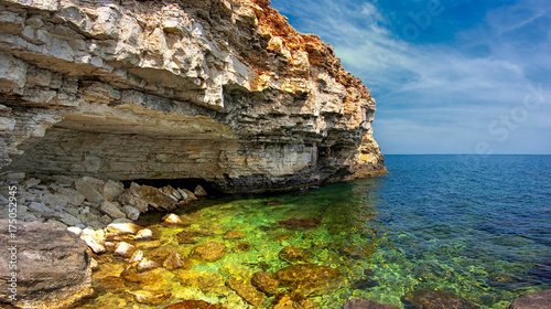 Deurstickers Cyprus Rocky precipitous seashore, beautiful lagoon with saturated water