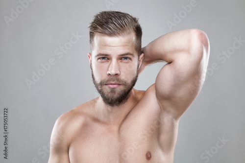 Aluminium Portrait of young bearded man with a new hair cut