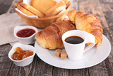 breakfast with coffee cup and croissant