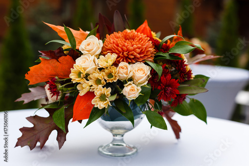 autumn bouquet in a vase on a white table Poster