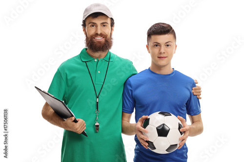Soccer coach and a teenage player with a football