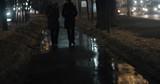 Sidewalk in dark winter city and two women friends walking and having a talk - 175061789