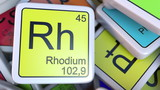 Rhodium Rh block on the pile of periodic table of the chemical elements blocks. Chemistry related 3D rendering - 175078730