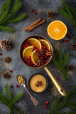 mulled wine and ingredients on dark grey concrete surface. - 175079943