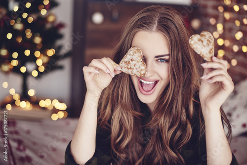 Crazy woman holding cookies in hand Poster