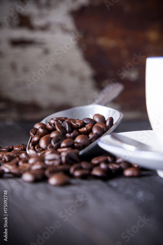 Fotobehang Koffiebonen Coffee beans in iron scoop