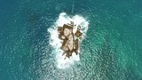 Overhead aerial, waves crash on rocks in Cabo San Lucas - 175101761