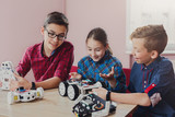 Stem education. Kids creating robots at school - 175102793