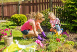 Mother and daugter time planting flowers - 175102928