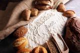 gluten free breads, glutenfree word written and bread rolls on grey background - 175103302