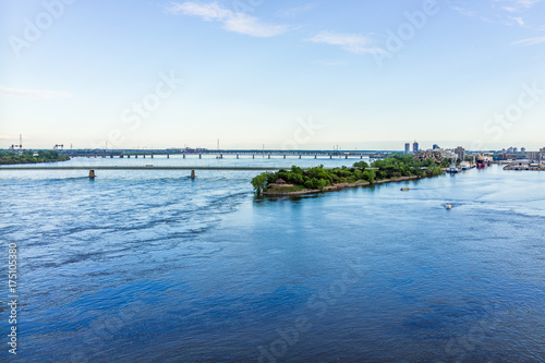 Keuken foto achterwand Schip Aerial view of old port area with Champlain and Victoria bridges in city in Quebec region during sunset