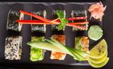 Japanese sushi set on a rustic dark background. - 175110132