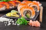 Japanese sushi set on a rustic dark background. - 175111303