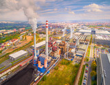 Aerial view of modern combined heat and power plant. Fuming chimney with sulphur removal unit. Heavy industry from above. Power and fuel generation in European Union.  - 175122788