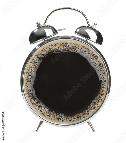 Hot coffee placed in retro alarm clock for coffee time concept.