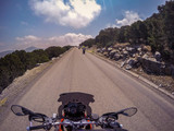 POV ridding a motorcycle on a road