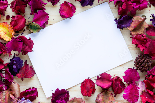 flowers dried aromatic, with paper, sheet, on wood background Poster