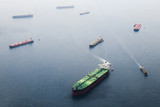Big tanker with two helicopter platforms stay on anchor