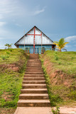 Local church on the hill at top of concete stairs
