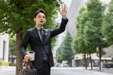 Fototapety portrait of young asian businessman on street