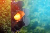 Yellow light of traffic lights in summer city - 175163311