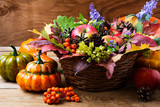Fall wicker basket table centerpiece with squash - 175164104