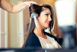 Portrait of a happy woman at the hair salon - 175166707