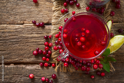Poster cranberry drink on wooden surface