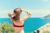 Young woman enjoying the summer with ocean / sea view. - 175173501