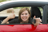 attractive woman smiling proud sitting at driver seat holding and showing car key in new automobile buying and renting - 175175580