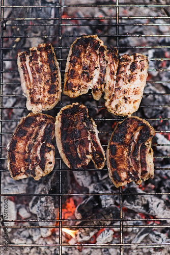 Poster Steakhouse Grilled meat/Fried steak on metal grill.Top view