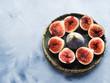 Dish of purple italian figs on gray background. Summer autumn fruit snack - 175176775