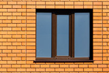 window in a brick wall in the house - 175179129