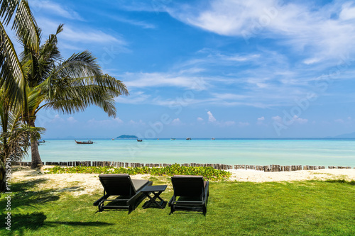 Amazing view of beautA greaiful beach with palm trees, chaises and transparent turquoise water Poster