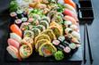 Tasty sushi set made of salmon and avocado
