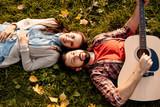 Couple lying on grass - 175204548