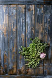 Bundle of fresh organic herbs oregano with garlic over old wooden plank background. Top view with copy space. Food background - 175206146
