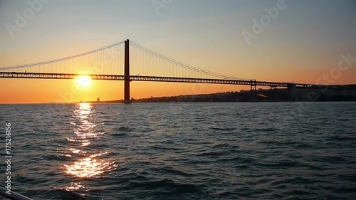 Amazing Sunset Behind Famous Bridge In Tagus River. Lisbon is the capital and the largest city of Portugal © Roddig